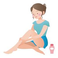 脚のマッサージをする女性
